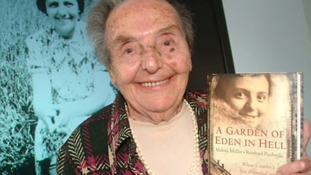 Alice Herz-Sommer with A Garden of Eden In Hell, a book exploring her life story. Picture: Polly Han