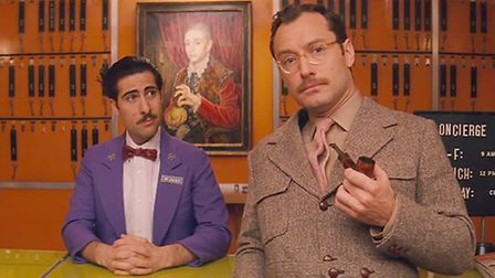 Jason Schwartzman and Jude Law in The Grand Budapest Hotel, with the painting of Ed in the backgroun