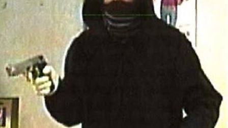 A CCTV still of the robbery at Lloyds TSB in Finchley Road on May 12, 2012