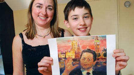 Marina and Andrew Smith, 12, with a copy of the portrait Andrew painted of Nick Clegg MP. Picture: P