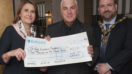 Alexandra Lavery presents cheque to Mitch Winehouse with Mayor of Camden Cllr Jonathan Simpson. Pict