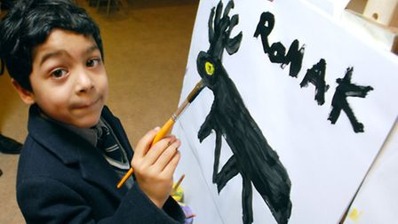 Artist Ronak Chadra Berges, six, gives a live demonstration of his skill after holding a Q&A session