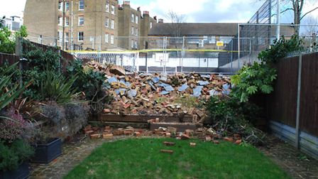 The pile of rubble at the end of resident Dan Roman's garden. Picture: Polly Hancock