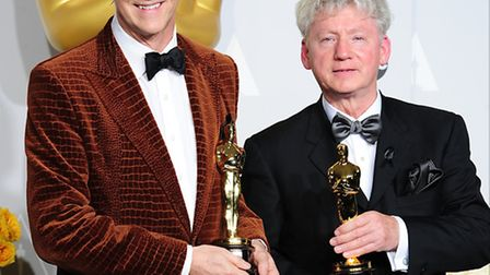 Filmmakers Malcolm Clarke (left) and Nick Reed in the press room with their Oscar awards for The Lad