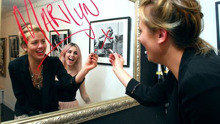 Gabrielle du Plooy and Rachel Howlett put the finishing touches to Zebra One Gallery before the open