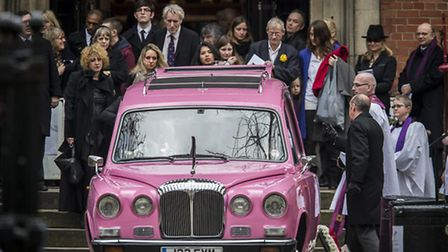 Family members and friends behind the pink hearse carrying the coffin of Roger Lloyd Pack who played