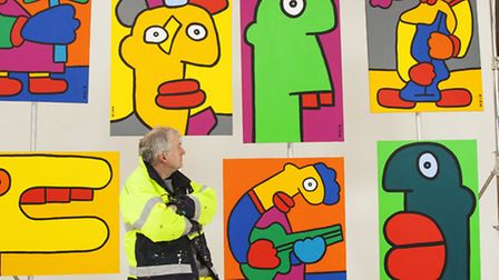 Thierry Noir next to his wall in Shoreditch, photo Mitchell McLennan