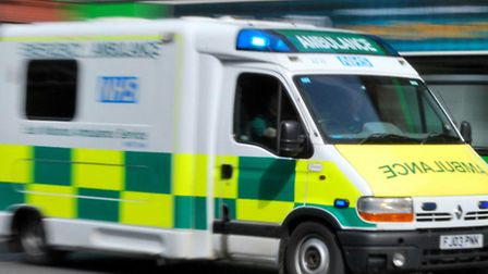 The cyclist was rushed to hospital by paramedics after colliding with a car and smashing through one