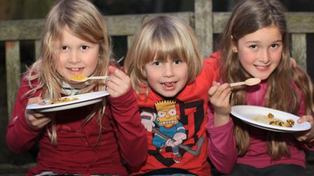 Liv Galand, left, with siblings Max and Selma enjoy some food at the Edible East Feast hosted by Gro