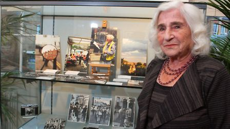 Photographer Dorothy Bohm with some of her work on display at Burgh House, as part of the Photograph
