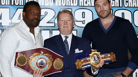 Dereck Chisora (left), promoter Frank Warren (centre) and Tyson Fury during a press conference at Th