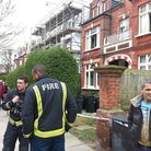 Firefighters at the scene of the fire in Broadhurst Gardens this morning