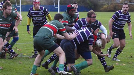 League leaders Belsize Park (in purple) beat Haringey Rhinos 34-14 in November. The two sides meet a