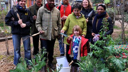 People take part in The Big Dig at Dalston Eastern Curve Garden
