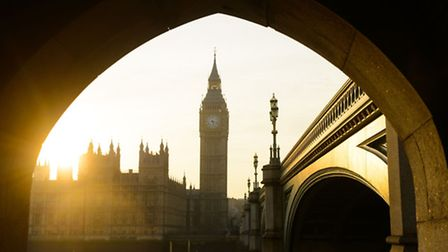 The sun setting behind the Houses of Parliament, in Westminster, central London.