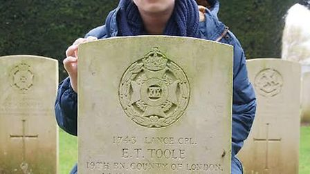 Jack Kennedy with his great-great uncle's WW1 gravestone on the Somme battle fields