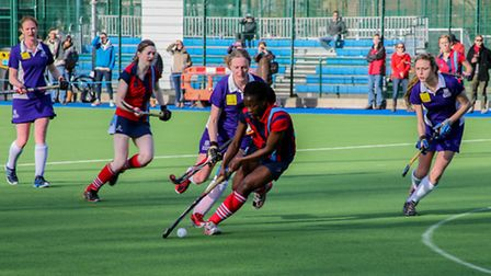 Hampstead & Westminster's Kike Lawal (centre) in action against Sevenoaks in last month's EH Cup sem