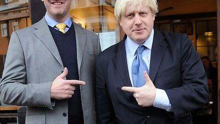 Hampstead and Kilburn candidate Simon Marcus with Boris Johnson outside the West Fish Cafe. Picture: