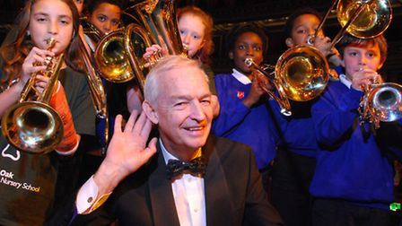 Compere Jon Snow with brass players from Gospel Oak School and Holy Trinity and St. Silas School. Pi