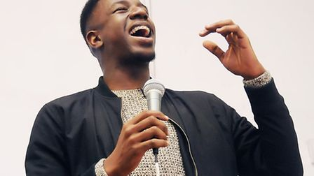 Jermain singing for his family and friends ahead of The Voice final show. Photo Dieter Perry