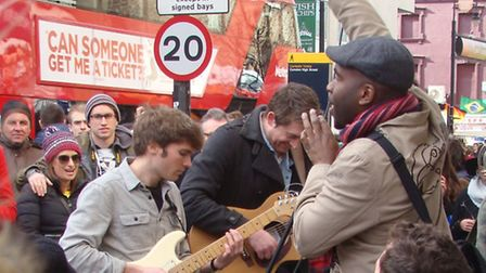 Buskers congregate outside Camden Underground Tube as they protest against Camden Council's new lice