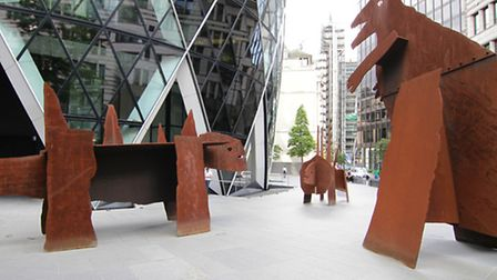 """""""The good, the bad, and the ugly"""" sculptures by Jake and Dinos Chapman, outside The Gherkin in Londo"""