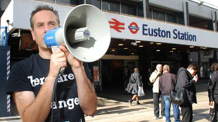 Danny Shine shouts his message outside Euston station. Picture: Polly Hancock