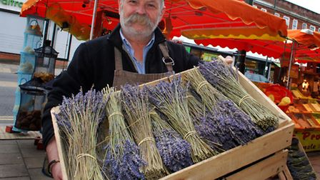 Claude Nicourt from soap stall Le Maison d'Antonin with a crate of lavender. Picture: Polly Hancock.