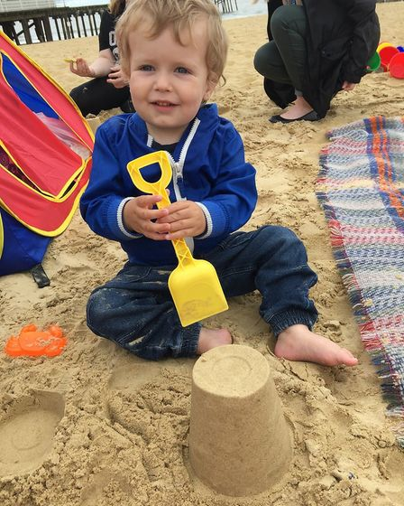 Jake White takes part in the FNP sandcastle competition. Picture: courtesy of ECCH