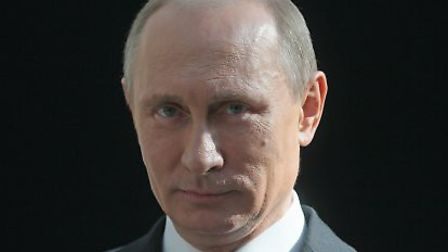 Russia's President Vladimir Putin looks on during his annual televised question-and-answer session i