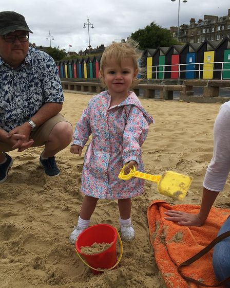Sophia Jones gets busy building sandcastles at the teddy bears' picnic. Picture: EAST COAST COMMUNIT