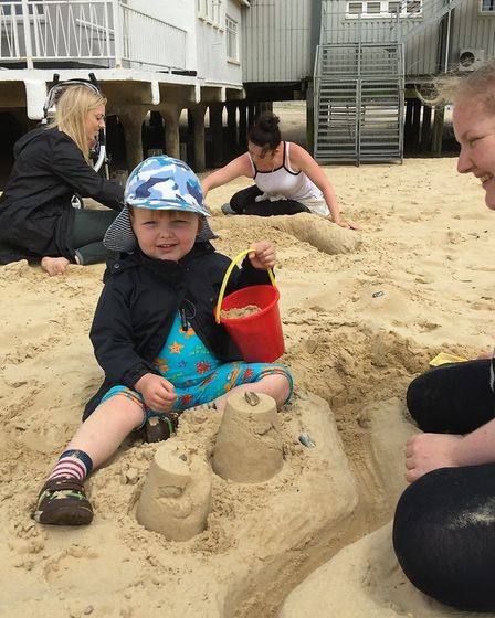 Sandcastle fun for three year old Jackson Woods. Picture: courtesy of ECCH