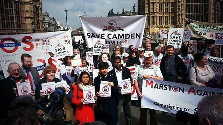 Campaigners from SOS Camden and Save Camden from HS2 join the protest outside parliament today. Pict