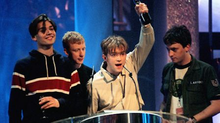 Blur win a Brit award in 1995: (From left) Alex James, Dave Rowntree, Damon Albarn and Graham Coxon.
