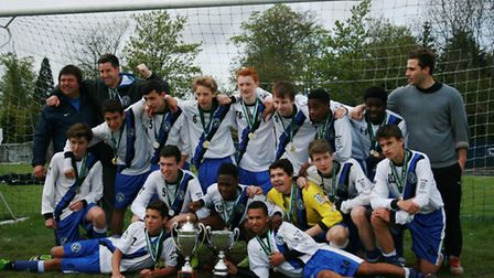 The Hampstead FC Under-15s squad show off their trophies