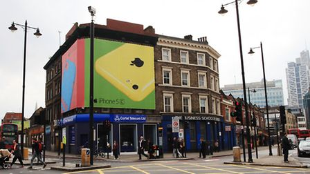 Apple® ad on the corner of Shoreditch High Street and Commercial Street.