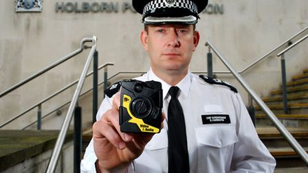 Camden Borough Commander C.S. B.J. Harrington with one of the new police video cameras. Picture: Pol