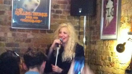 Courtney Love in Hayden Wylds coffee and record shop.