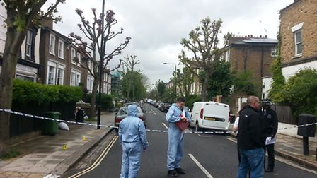Forensics officers at the scene on Friday