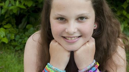 Emma Cohen has been making rainbow bracelets and selling them in aid of Cancer UK. Picture: Nigel Su