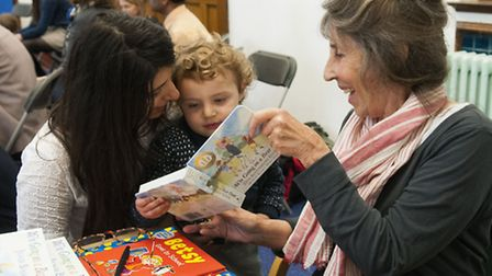 Illustrator Helen Oxenbury with a young fan. Picture: Nigel Sutton