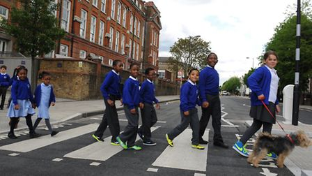 Pupils from Queensbridge School use a new zebra crossing that they campaigned for