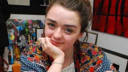 Actress Maisie Williams signs a portrait of herself at Zebra One Gallery NW3. Picture: Polly Hancock