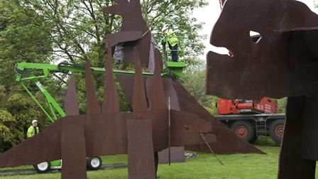 The dinosaurs being installed in their new home in Golders Hill Park