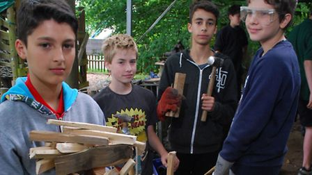 The Village project at King Alfred's School. Pictured from left Adel, Sonny, Areil and Zac chopping