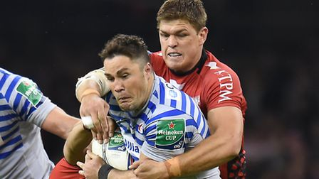 Toulon's Juan Smith (right) tackles Saracens' Brad Barritt