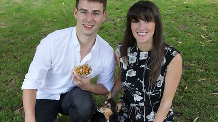 Leean and Sam Young with dog Nacho and their healthy Sniffy's biscuits. Picture: Jonathan Goldberg