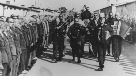 An inmate orchestra at Mauthausen concentration camp, in Austria, �accompanied� the recaptured inmat