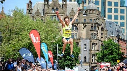 Great Britain's Chris Tomlinson competes in the long jump in Albert Square during the BT Great CityG