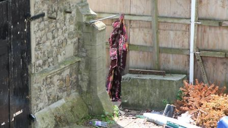 The squatters are allegedly defecating in the Old School House yard behind the makeshift curtain. Ph